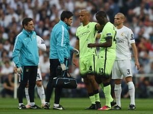 Manchester City captain Vincent Kompany limps off the field during his side's Champions League semi-final second leg against Real Madrid on May 4, 2016