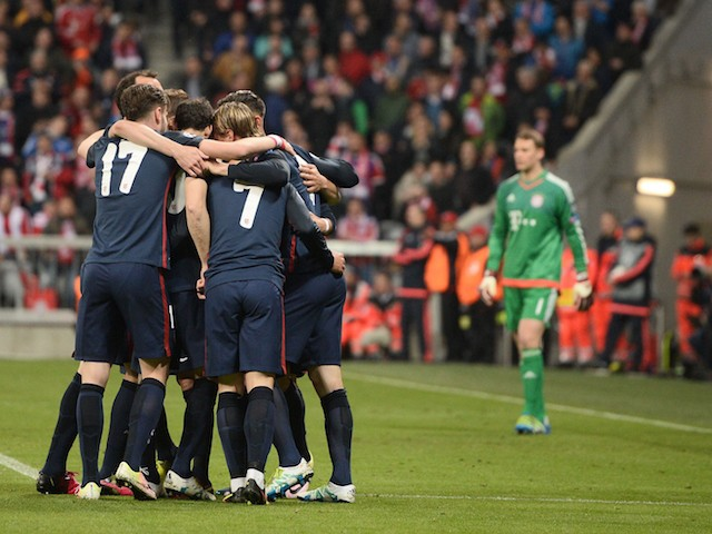 Atletico Madrid players celebrate during the Champions League semi-final second leg against Bayern Munich on May 3, 2016