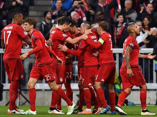 Bayern Munich players celebrate Xabi Alonso's opening goal in the Champions League semi-final against Atletico Madrid on May 3, 2016