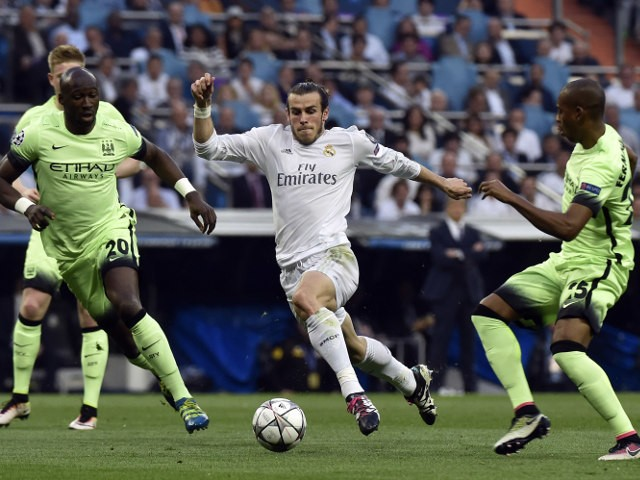 Real Madrid's Gareth Bale bursts past Eliaquim Mangala and Fernando of Manchester City during the Champions League semi-final second leg at the Bernabeu on May 4, 2016