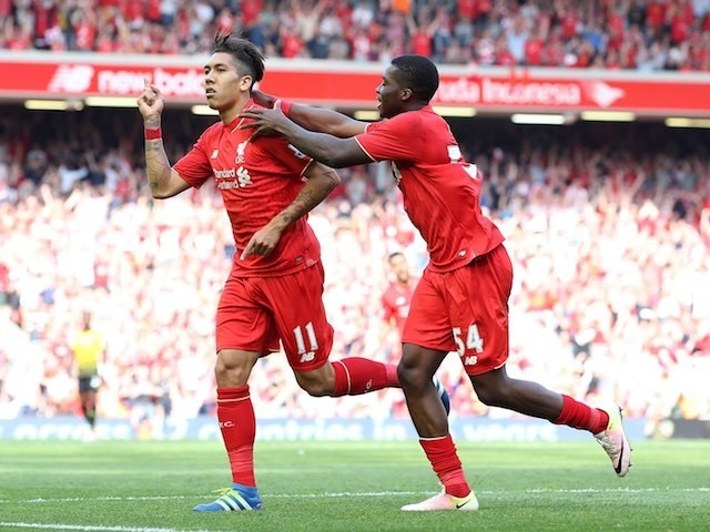 Roberto Firmino celebrates with Sheyi Ojo during the Premier League game between Liverpool and Watford on May 8, 2016