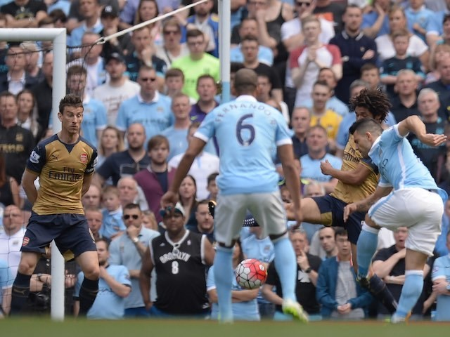 Sergio Aguero scores the opener during the Premier League game between Manchester City and Arsenal on May 8, 2016