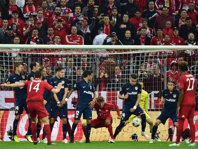 Xabi Alonso scores Bayern Munich's first goal in the Champions League semi-final second leg against Atletico Madrid on May 3, 2016