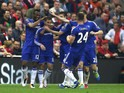 Chelsea players celebrate Eden Hazard's opener in the Premier League clash with Liverpool at Anfield on May 11, 2016