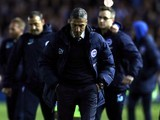 Brighton & Hove Albion manager Chris Hughton looks dejected after losing the Championship playoff semi-final first leg on May 13, 2016