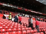 Supporters are evacuated from the abandoned Premier League match between Manchester United and Bournemouth on May 15, 2016