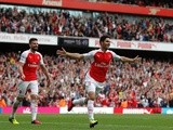 Mikel Arteta celebrates scoring during the Premier League game between Arsenal and Aston Villa on May 15, 2016