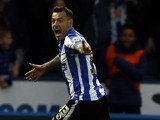 Ross Wallace celebrates scoring for Sheffield Wednesday in the Championship playoff semi-finals on May 13, 2016