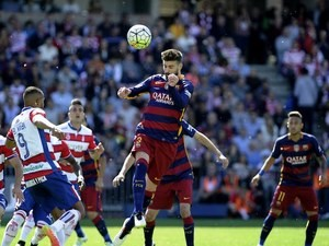 Big Gerard Pique heads the ball during the La Liga game between Granada and Barcelona on May 14, 2016