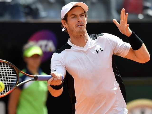 Andy Murray returns to David Goffin during their Rome ATP tournament tennis match at the Foro Italico on May 13, 2016