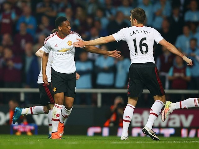 Anthony Martial celebrates scoring with Michael Carrick during the Premier League game between West Ham United and Manchester United on May 10, 2016