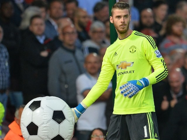 David de Gea catches an inflatable ball during the Premier League game between West Ham United and Manchester United on May 10, 2016
