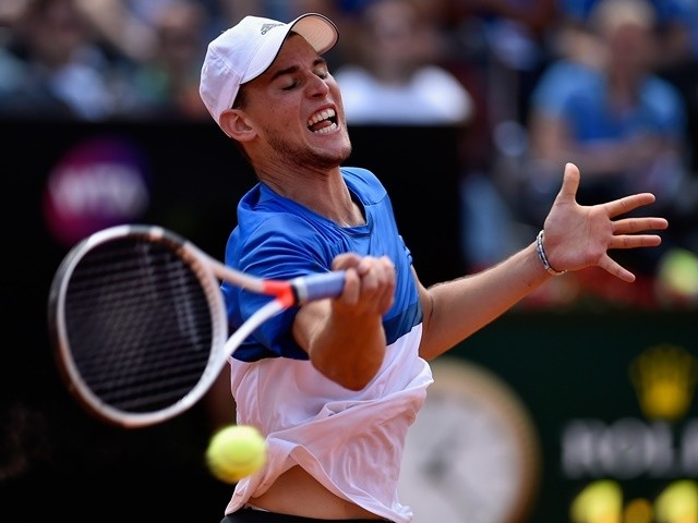 Dominic Thiem plays a forehand in his match against Roger Federer on day five of the Italian Open on May 12, 2016