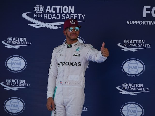 Lewis Hamilton celebrates being on pole for the Spanish GP on May 14, 2016