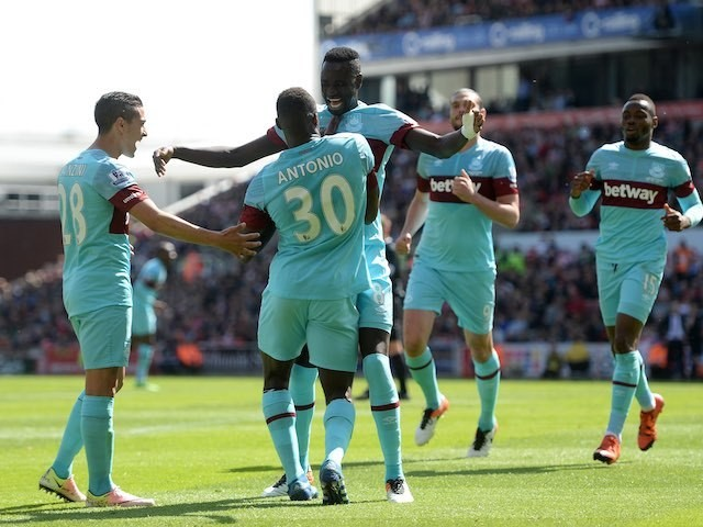 Michail Antonio celebrates scoring during the Premier League game between Stoke City and West Ham United on May 15, 2016
