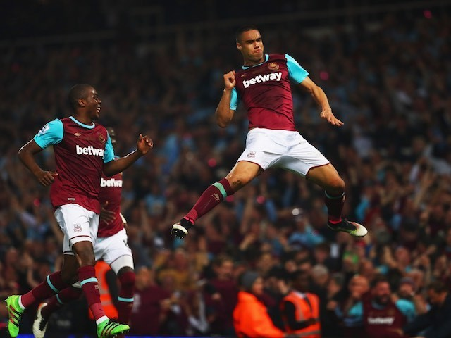 Winston Reid grabs the winner during the Premier League game between West Ham United and Manchester United on May 10, 2016