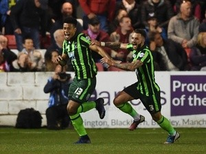 Lyle Taylor of AFC Wimbledon celebrates with teammate Callum Kennedy after scoring a goal in the first period of extra time to give his team a 3-2 aggregate lead during the League Two playoffs second leg against Accrington Stanley on May 18, 2016