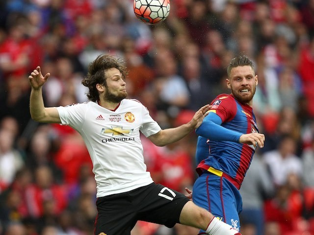 Daley Blind and Connor Wickham in action during the FA Cup final between Crystal Palace and Manchester United on May 21, 2016