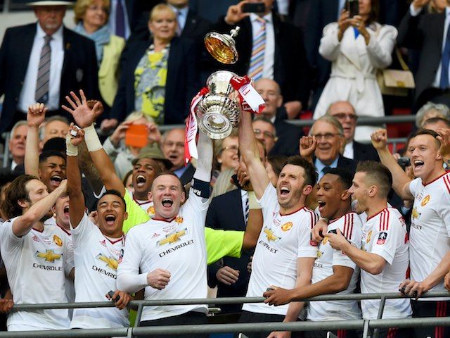 Wayne Rooney and Michael Carrick lift the FA Cup trophy on May 21, 2016
