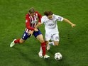 Fernando Torres and Luka Modric in action during the Champions League final between Real Madrid and Atletico Madrid on May 28, 2016