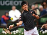 Kei Nishikori goes for a shot during his fourth round match with Richard Gasquet at the French Open on May 29, 2016