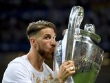 Sergio Ramos kisses the trophy after the Champions League final between Real Madrid and Atletico Madrid on May 28, 2016