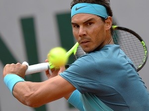 Rafael Nadal returns the ball to Sam Groth at the French Open in Paris on May 24, 2016