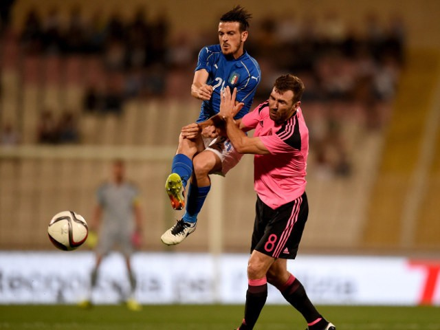 Alessandro Florenzi of Italy (L) in action during the international friendly between Italy and Scotland on May 29, 2016 in Malta