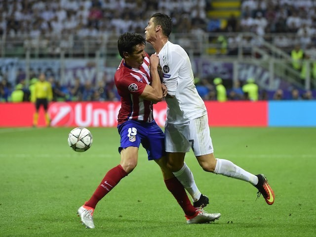 Cristiano Ronaldo clashes with Stefan Savic during the Champions League final between Real Madrid and Atletico Madrid on May 28, 2016