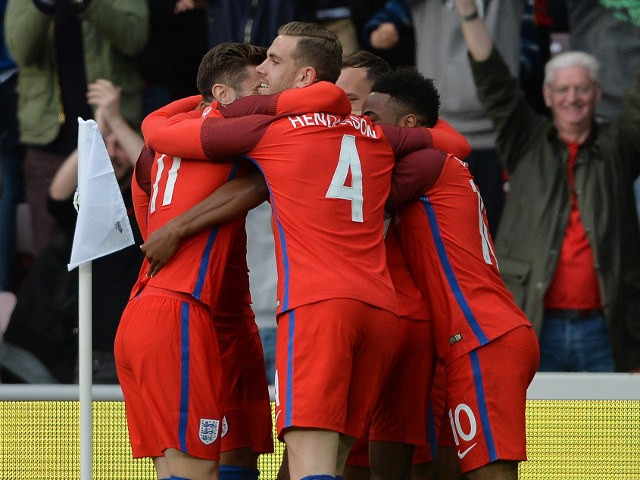England players celebrate Marcus Rashford's goal after less than three minutes of their match against Australia at the Stadium of Light on May 27, 2016