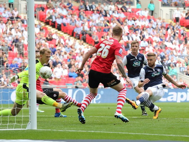 Millwall's Mark Beevers pulls a goal back for his side during their League One playoff final against Barnsley at Wembley on May 29, 2016