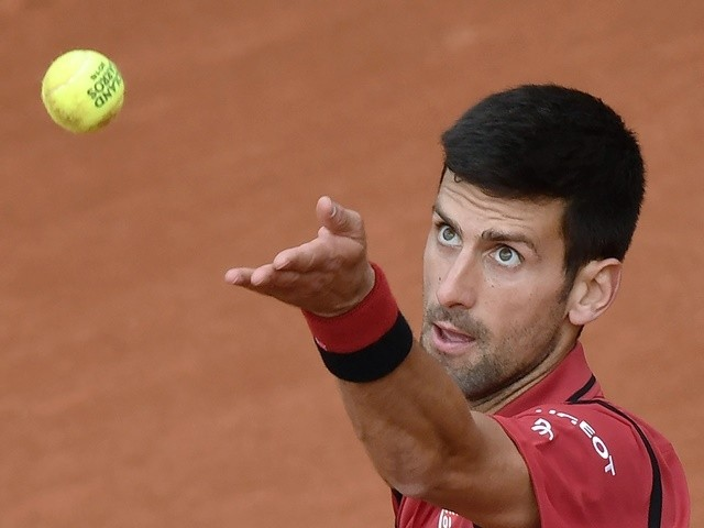 Novak Djokovic serves the ball to Lu Yen-Hsun during their men's first-round match at the French Open in Paris on May 24, 2016