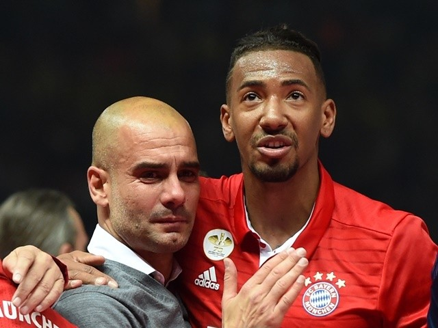 Pep Guardiola is hugged by Jerome Boateng after Bayern Munich defeated Borussia Dortmund in the DFB-Pokal final on May 21, 2016