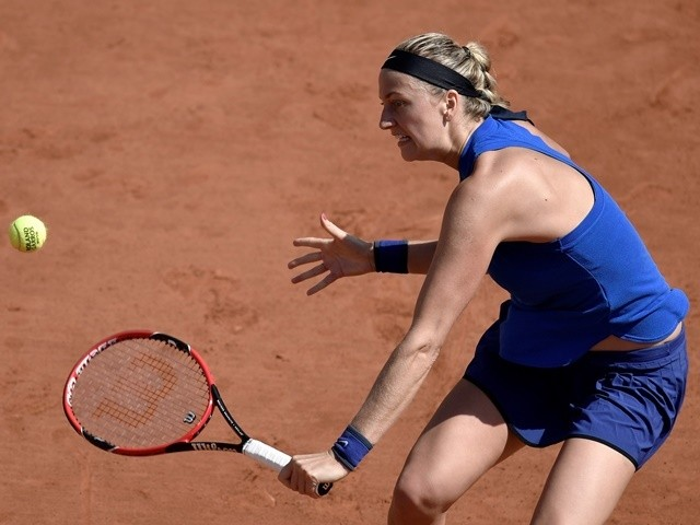 Petra Kvitova returns the ball to Hsieh Su-Wei at the French Open in Paris on May 25, 2016