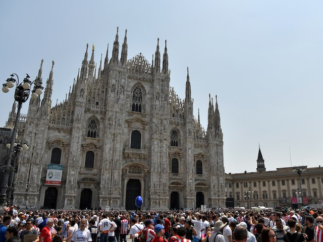 Atletico Madrid and Real Madrid fans gather outside the Piazza Duomo in Milan ahead of the Champions League final between the two sides on May 28, 2016