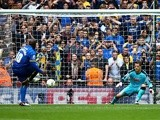 Adebayo Akinfenwa of Wimbledon scores his side's second goal from a penalty on May 30, 2016