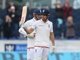 England batsman Alastair Cook raises his bat after reaching 10,000 Test runs against Sri Lanka on May 30, 2016