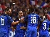 France players celebrate after scoring in their friendly match against Cameroon on May 30, 2016
