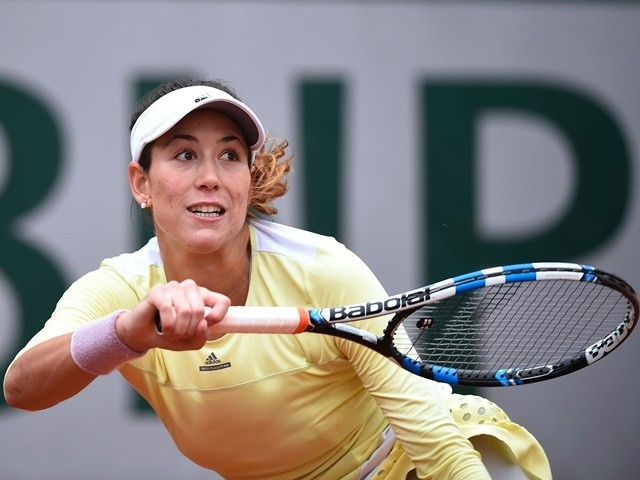 Garbine Muguruza returns the ball to Samantha Stosur during their women's semi-final match at the French Open on June 3, 2016