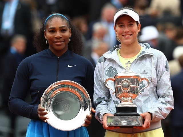 Serena Williams and champion Garbine Muguruza pose after the French Open final on June 4, 2016