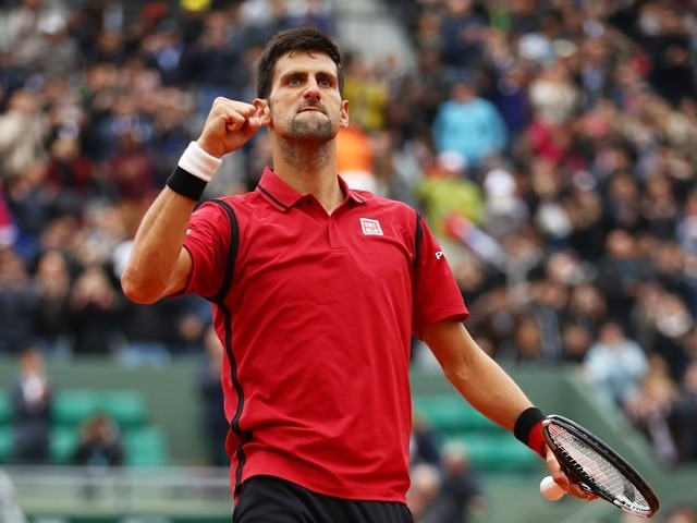 Novak Djokovic celebrates victory against Dominic Thiem in the French Open semis on June 3, 2016