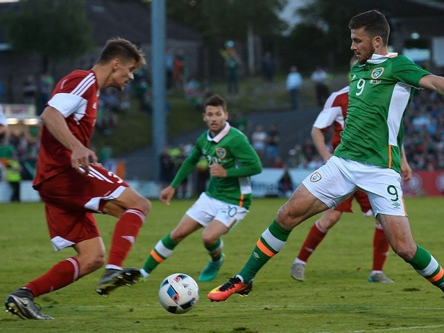 Republic of Ireland's Shane Long vies with Belarus's Aleksandr Martynovich on May 31, 2016