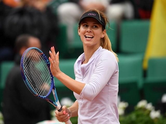 Tsvetana Pironkova of Bulgaria celebrates victory over Agnieszka Radwanska at the French Open at Roland Garros on May 31, 2016