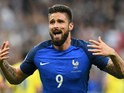 France's forward Olivier Giroud celebrates after scoring the 1-0 during the Euro 2016 group A football match between France and Romania at Stade de France, in Saint-Denis, north of Paris, on June 10, 2016