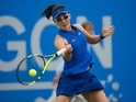 Zheng Saisai of China in action during her match against Tara Moore of Great Britain on day six of the WTA Aegon Open on June 11, 2016