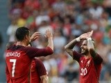 Portugal's forward Ricardo Quaresma celebrates with teammate Cristiano Ronaldo after scoring against Estonia on June 8, 2016