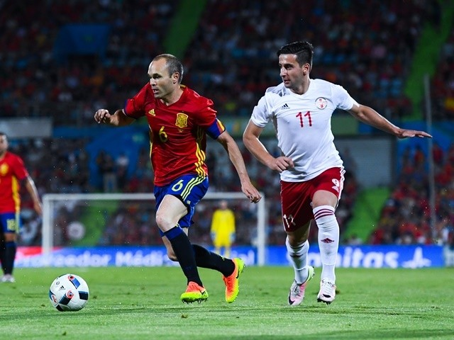Andres Iniesta of Spain competes for the ball with Chanturia of Georgia during an international friendly on June 7, 2016