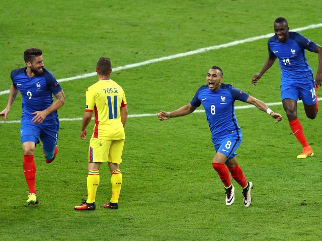 Dimitri Payet of France celebrates scoring his team's second goal during the UEFA Euro 2016 Group A match between France and Romania at Stade de France on June 10, 2016 in Paris, France