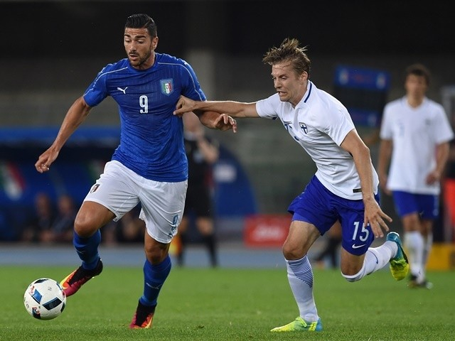 Graziano Pelle of Italy is challenged by Markus Halsti of Finland during the international friendly on June 6, 2016