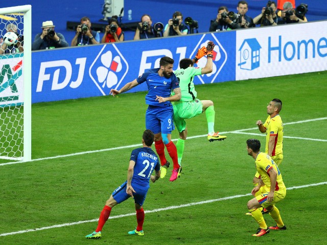 Olivier Giroud of France heads the ball to score his team's first goal during the UEFA Euro 2016 Group A match between France and Romania at Stade de France on June 10, 2016 in Paris, France